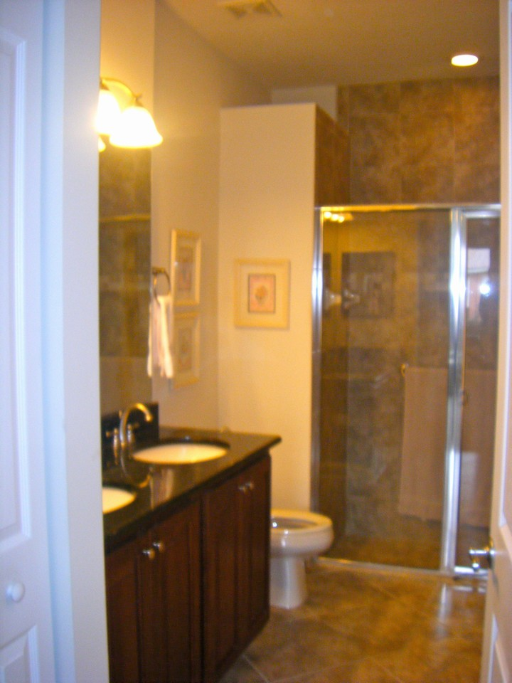 master bath, his/her sinks, floor to ceiling shower tiles