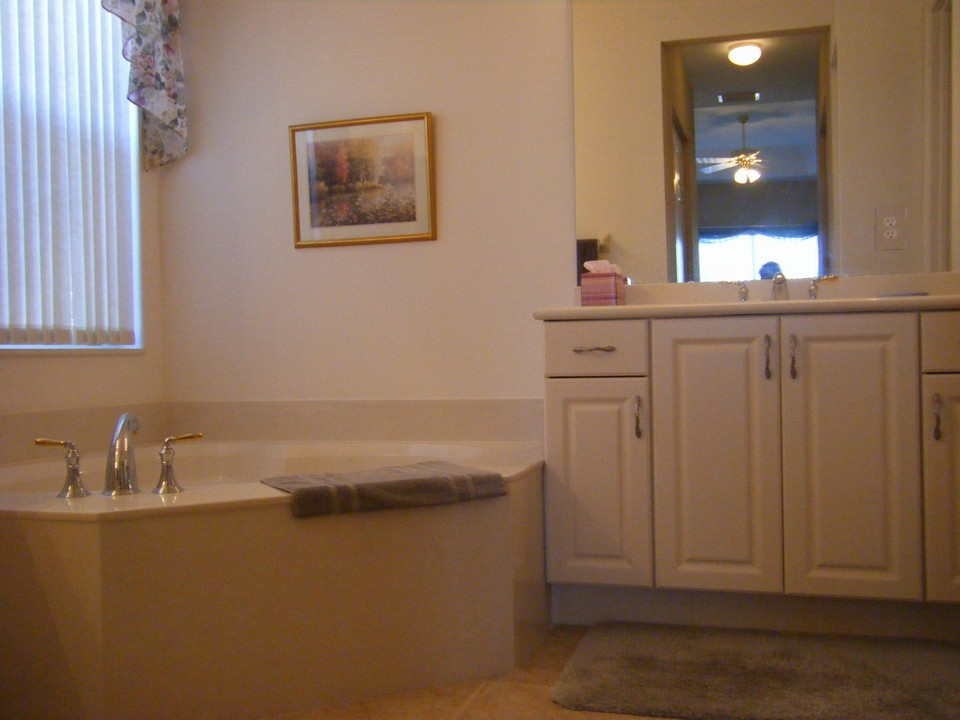 master bath, roman tub, his & her sinks with cultured marble counter tops