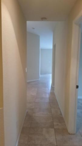 hallway leading to bedrooms, laundry room and garage
