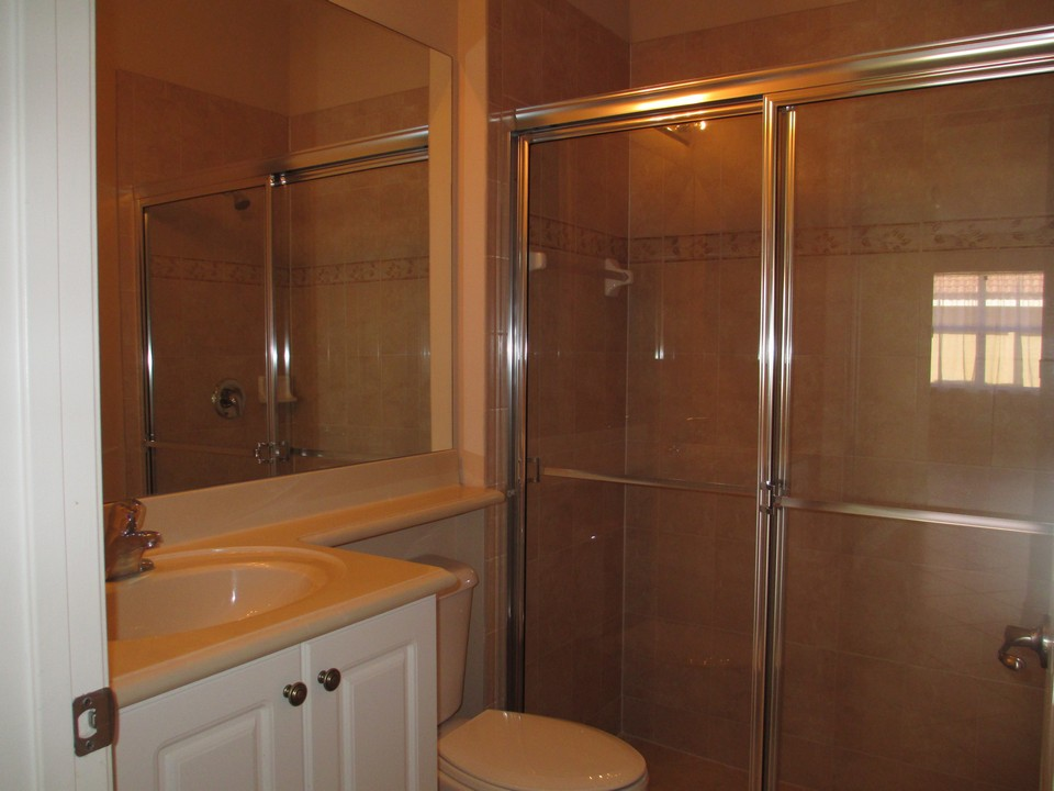 guest bath on first floor with shower & raisted counter