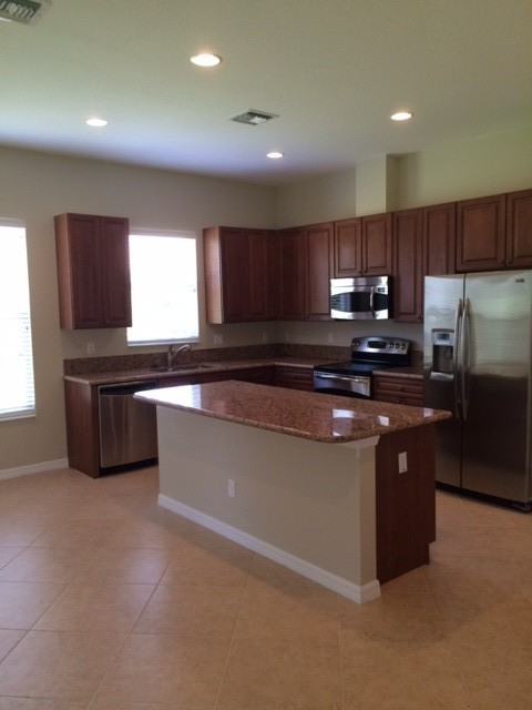 granite counters, cherry cabinets, ss appliances