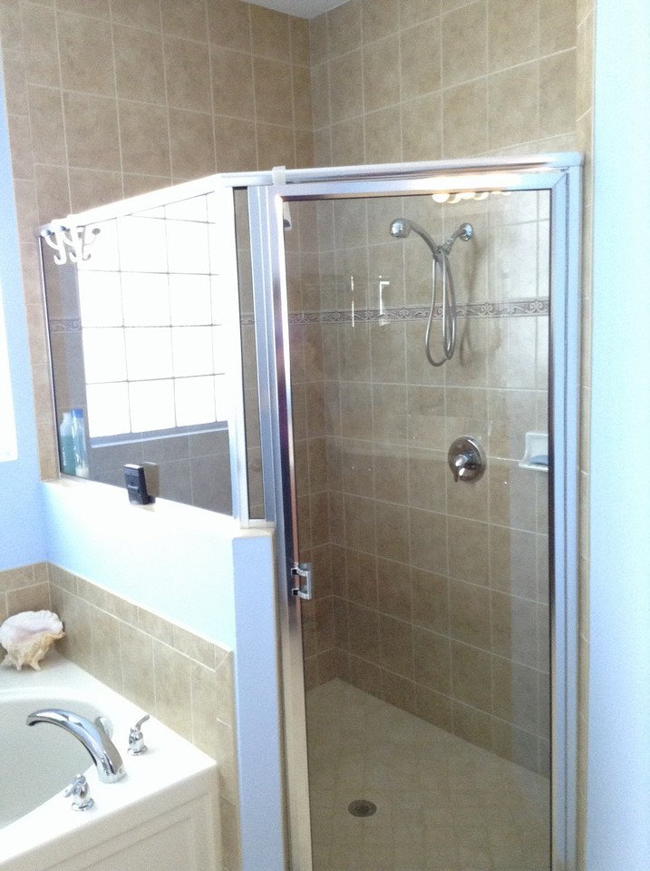 tub and shower with floor to ceiling tile
