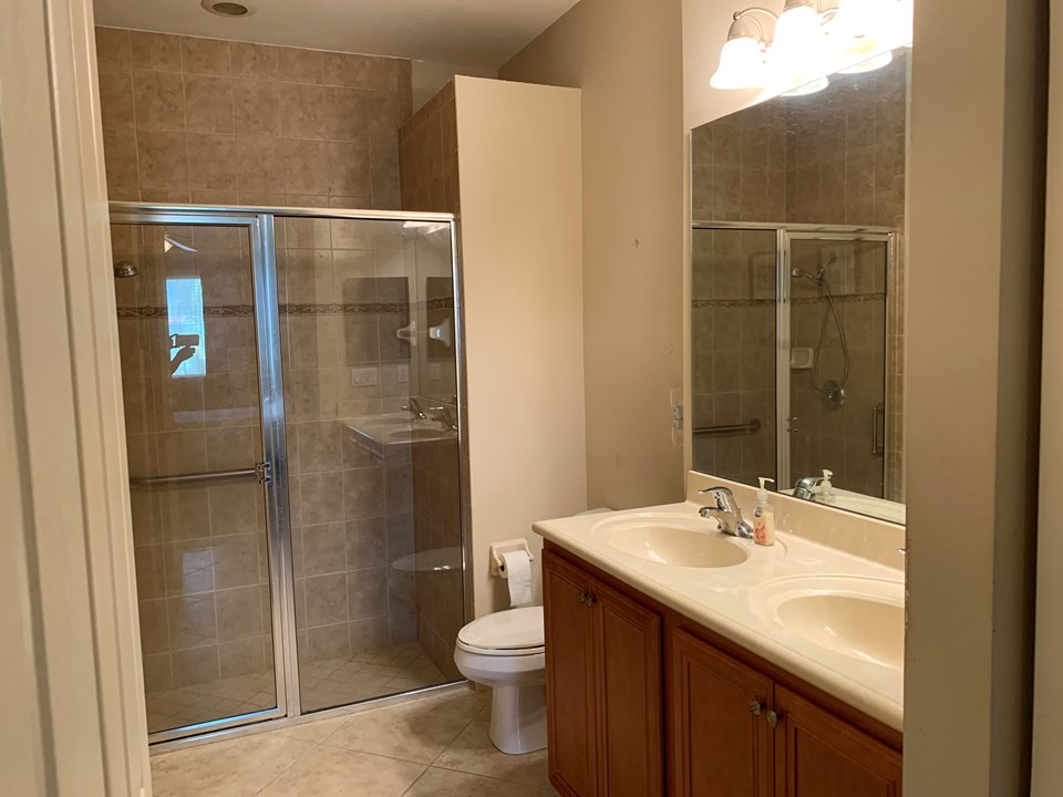 master bath with shower and dual sinks