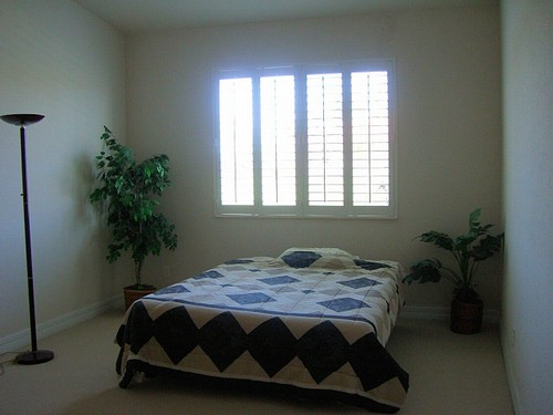 master bedroom with plantation shutters